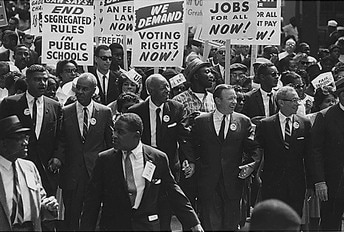 1963 March on Washington. Photograph by Rowland Scherman for USIA (U.S. National Archives and Records Administration) [Public domain], via Wikimedia Commons https://commons.wikimedia.org/wiki/File:1963_march_on_washington.jpg