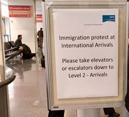 Immigration protest directional sign at San Francisco International Airport.